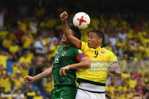 Colombia's forward Luis Muriel and Bolivia's defender Ronald Raldes vie for the ball during the 2018 FIFA World Cup qualifier football match in...