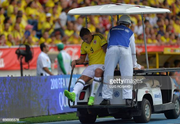 Colombia's forward Luis Muriel is carried out from the field during their 2018 FIFA World Cup qualifier football match against Bolivia in...