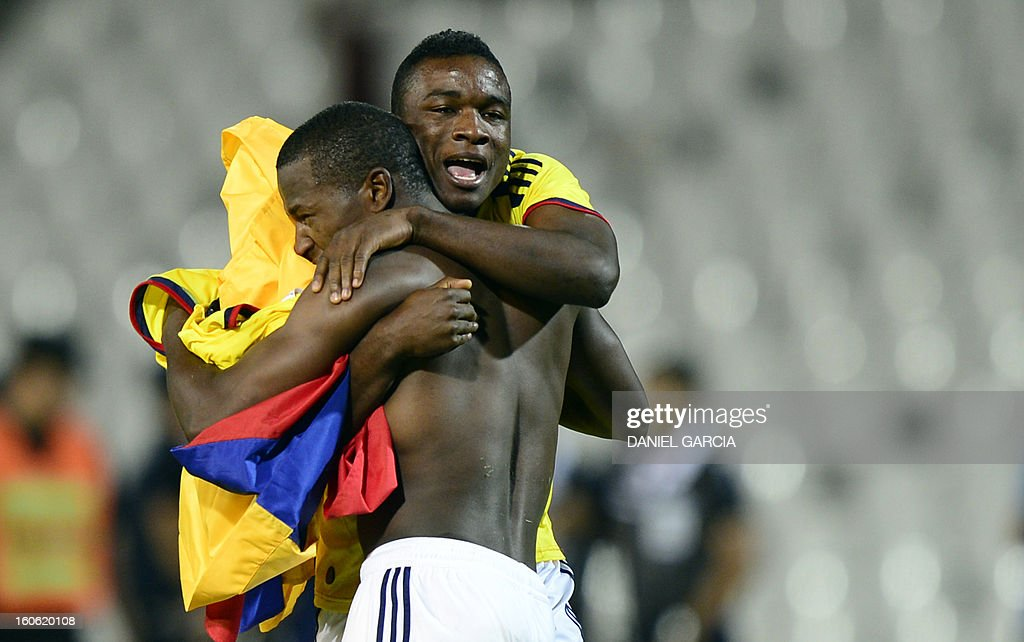 Colombia's forward Mauricio Cuero and forward Jhon Cordoba celebrate at the end of their South American U-20 final round football match against Paraguay at Malvinas Argentinas stadium in Mendoza on February 3, 2013. Colombia won 2-1. Four teams will qualify for the FIFA U-20 World Cup Turkey 2013.