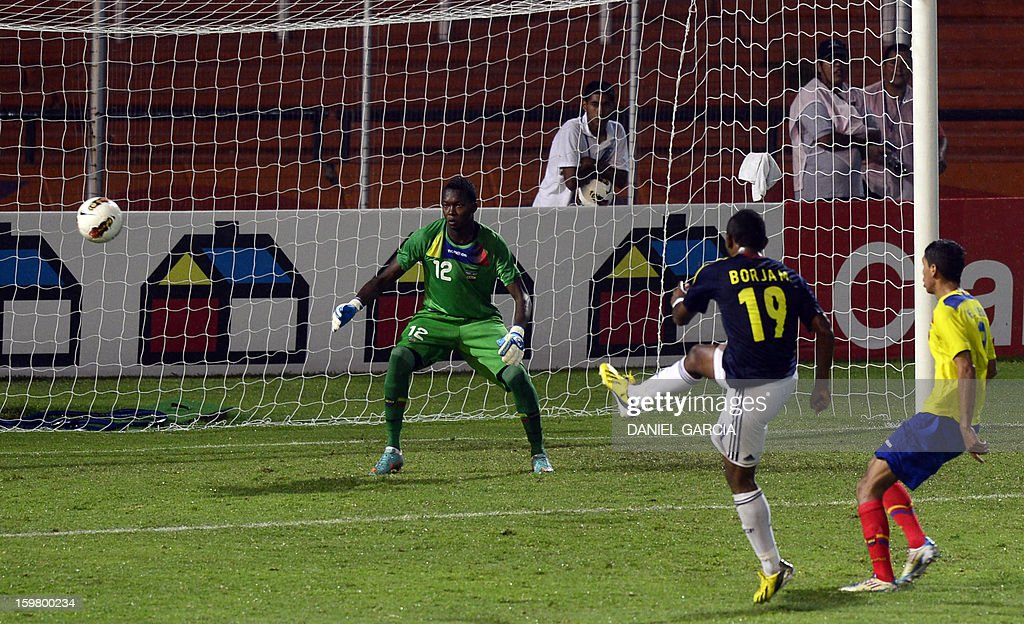 Colombia's forward Miguel Borja (2nd R) misses a goal in front of Ecuadorian goalkeeper Darwin Cuero during their South American U-20 final round football match at Malvinas Argentinas stadium in Mendoza, Argentina, on January 20, 2013. Four teams will qualify for the FIFA U-20 World Cup Turkey 2013.