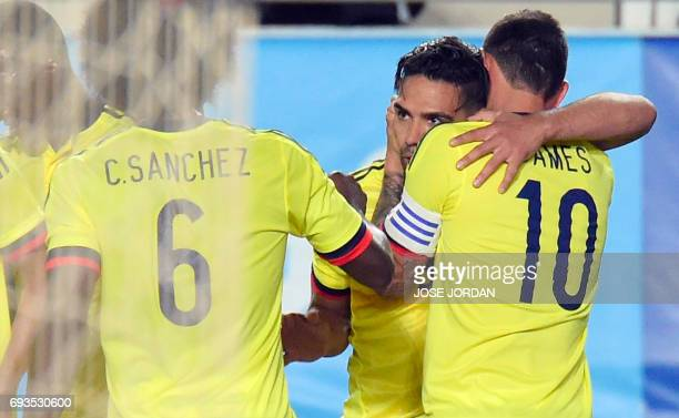 Colombia's forward Radamel Falcao celebrates a goal with Colombia's midfielder James Rodriguez during the friendly international football match Spain...