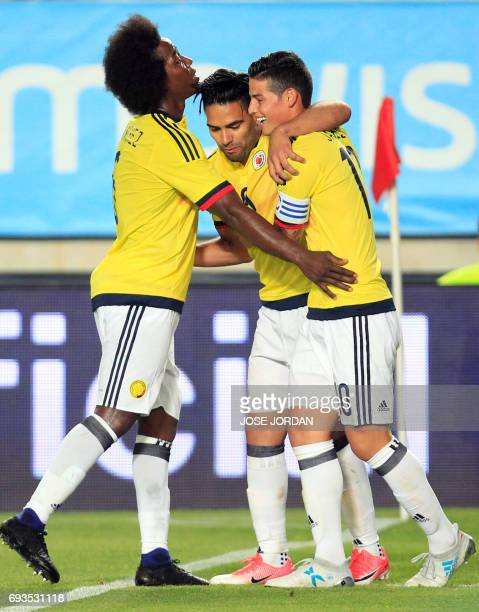 Colombia's forward Radamel Falcao celebrates a goal with Colombia's midfielder James Rodriguez and Colombia's midfielder Carlos Sanchez during the...