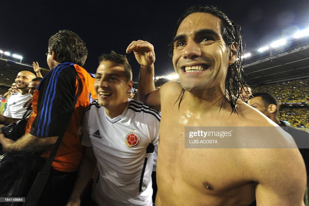 Colombia's forward Radamel Falcao Garcia (R) celebrates after qualifying for the Brazil 2014 FIFA World Cup after a 3-3 tie with Chile in a South American qualifier match, in Barranquilla, Colombia, on October 11, 2013.