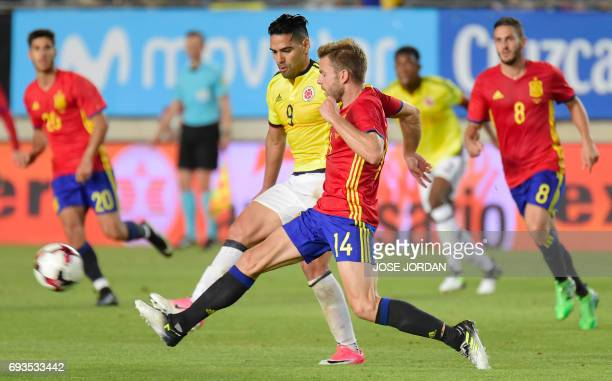 Colombia's forward Radamel Falcao vies with Spain's midfielder Asier Illarramendi during the friendly international football match Spain vs Colombia...