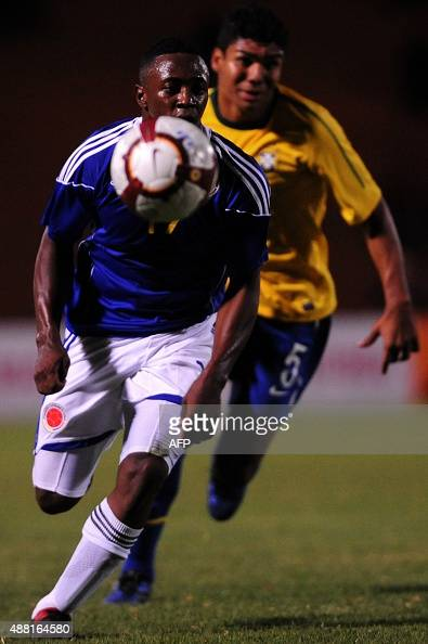 Colombia´s fullback Sebastian Viafara vies for the ball against Brazil´s halfbackCarlos Casimiro during their Under20 South American championship...