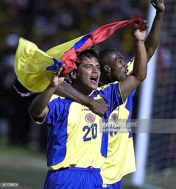 Colombia's Gerardo Bedoya and teammate Elkin Murillo celebrate their team's 10 victory over Mexico in the final of the Copa America 29 July 2001 at...