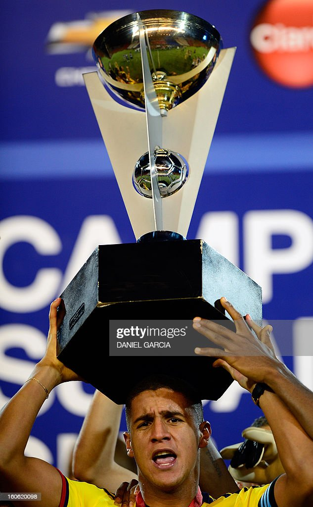 Colombia's goalkeeper Cristian Bonilla holds the trophy at the podium after winning the championship of their South American U-20 final round football match against Paraguay at Malvinas Argentinas stadium in Mendoza on February 3, 2013. Colombia defeated Paraguay 2-1, and both teams plus Uruguay and Chile qualified for the FIFA U-20 World Cup Turkey 2013.