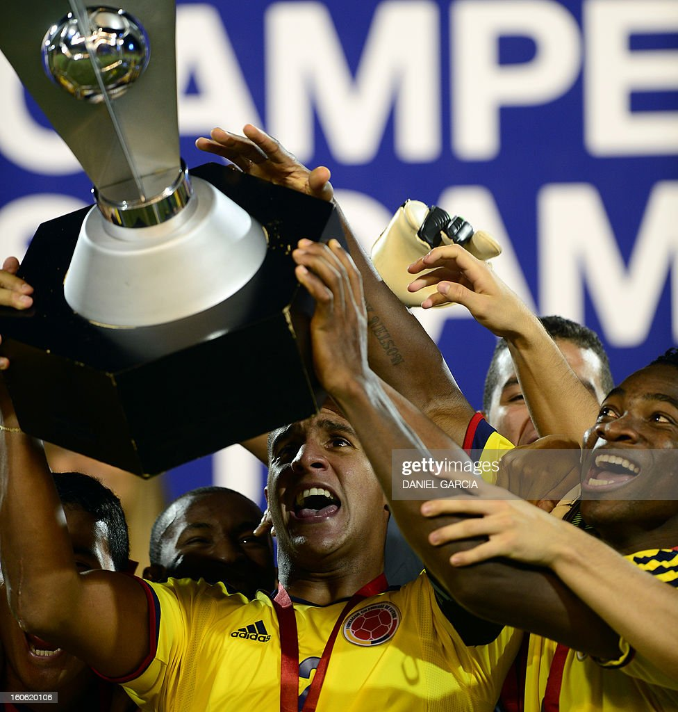 Colombia's goalkeeper Cristian Bonilla (C) holds the trophy at the podium next to other players after winning the championship of their South American U-20 final round football match against Paraguay at Malvinas Argentinas stadium in Mendoza on February 3, 2013. Colombia defeated Paraguay 2-1, and both teams plus Uruguay and Chile qualified for the FIFA U-20 World Cup Turkey 2013.