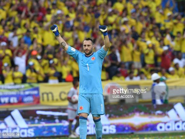Colombia's goalkeeper David Ospina celebrates after they defeat Bolivia in their 2018 FIFA World Cup qualifier football match in Barranquilla on...
