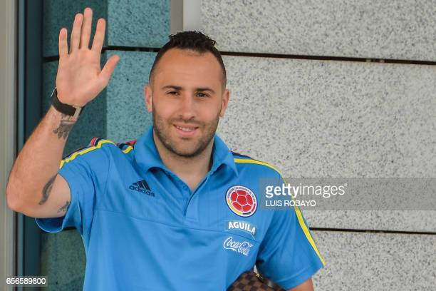 Colombia's goalkeeper David Ospina greets fans on the way to a training session at the Metropolitan Stadium in Barranquilla Colombia on March 22 on...