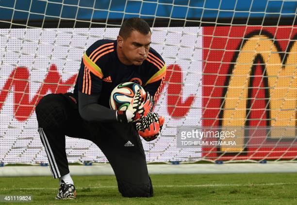 Colombia's goalkeeper Faryd Mondragon catches the ball during a training session at the Pantanal Arena in Cuiaba on June 23 on the eve of their Group...