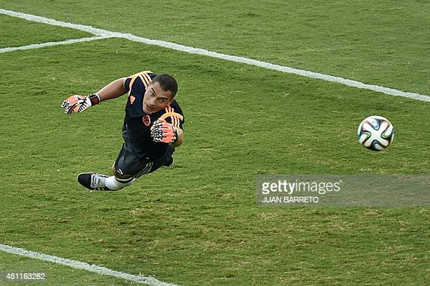 Colombia's goalkeeper Faryd Mondragon warms up prior to the start of a Group C football match between Japan and Colombia at the Pantanal Arena in...