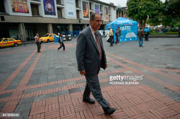 Colombia's government representative Juan Camilo Restrepo walks toward Ecuador's archbishop's palace before a meeting with ELN guerrillas in the...