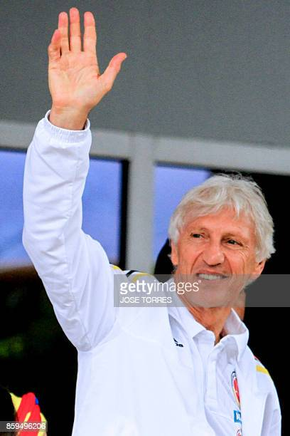 Colombia's head coach Jose Pekerman greets fans on the way to the Ernesto Cortissoz Internacional Airport in Barranquilla Colombia on October 9 to...