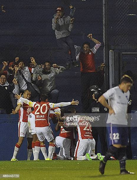 Colombia's Independiente de Santa Fe players celebrate scoring against Uruguay's Nacional during their Sudamericana Cup football match at the Parque...