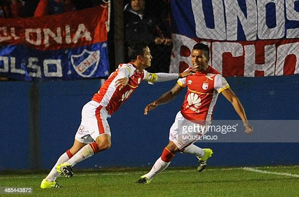 Colombia's Independiente de Santa Fe players Luis Seijas celebrates with Wilson Morelo after scoring against Uruguay's Nacional during their...