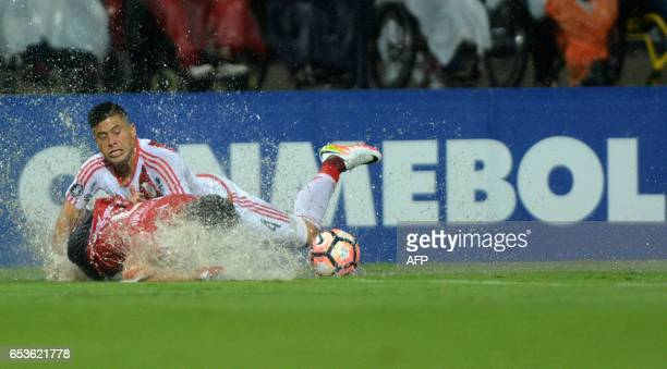 Colombia's Independiente Medellin Christian Marrugo vies for the ball with Argentina's River Plate Jorge Moreira during their Copa Libertadores 2017...