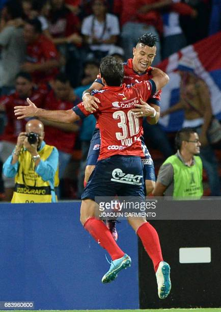 Colombia's Independiente Medellin defender Argentinean Valentin Viola celebrates with teammate forward Leonardo Castro after scoring a goal against...