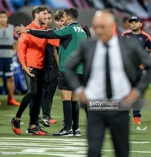 Colombia's Independiente Medellin head coach Argentinean Luis Zubeldia argues with Uruguayan referee Christian Ferreyra after being sent off during...
