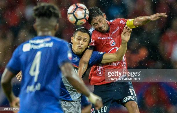 Colombia's Independiente Medellin midfielder Christian Marrugo vies for the ball with Ecuador's Emelec forward Argentinean Marcos Mondaini during...