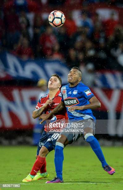 Colombia's Independiente Medellin midfielder Juan Quintero vies for the ball with Ecuador's Emelec midfielder Eduar Preciado during their 2017 Copa...