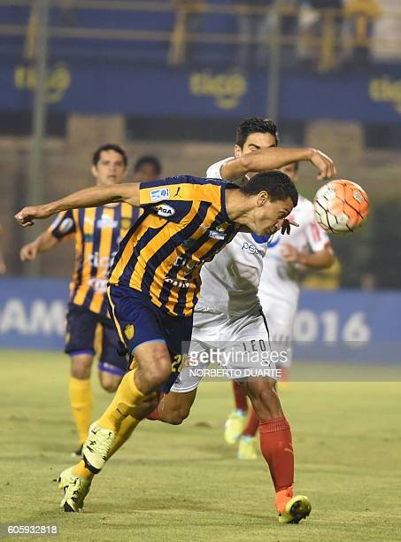 Colombia's Independiente Medellin player Hernan Hechalar vies for the ball with Paraguay's Sportivo Luqueño player Joel Benitez during their Copa...