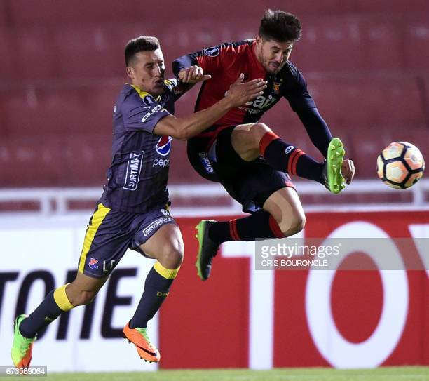 Colombias Independiente Medellin player Leonardo Castro vies for the ball with Peru's Melgar player Jean Barrientos during their Copa Libertadores...