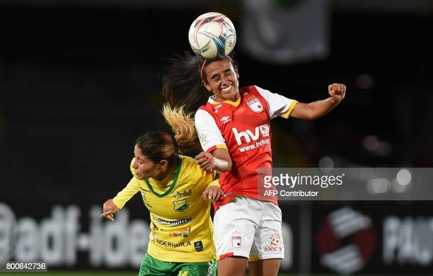 Colombia's Independiente Santa Fe player Gabriela Huertas vies for the ball with Atletico Huila player Vanesa Santana during their Women's Football...