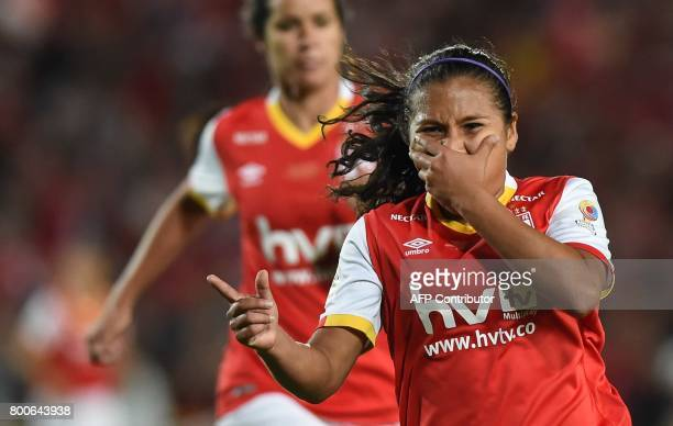 Colombia's Independiente Santa Fe player Leicy Santos celebrates after scoring against Atletico Huila during their Women's Football League...