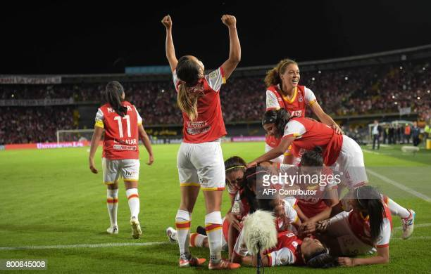 Colombia's Independiente Santa Fe player Leicy Santos celebrates with teammates after scoring against Atletico Huila during their Women's Football...