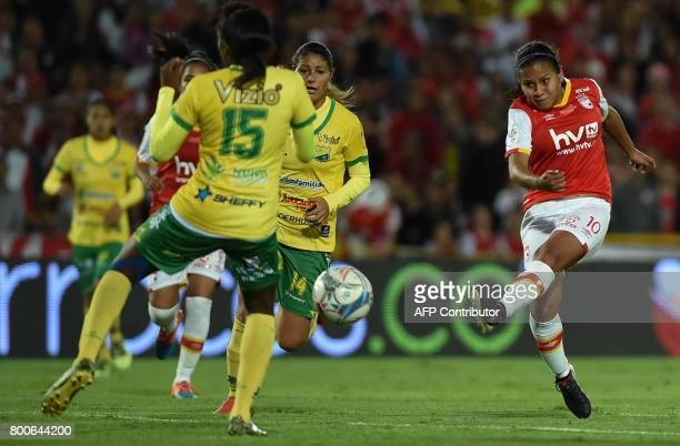 Colombia's Independiente Santa Fe player Leicy Santos kicks to score against Atletico Huila during their Women's Football League championship final...