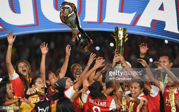 Colombia's Independiente Santa Fe players celebrate after winning their Women's Football League championship final match against Atletico Huila at El...