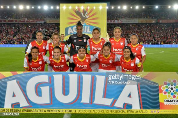 Colombia's Independiente Santa Fe team players pose before their Women's Football League championship final match against Atletico Huila at El Campin...