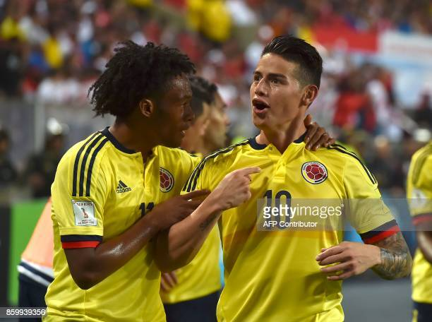 Colombia's James Rodriguez celebrates with Colombia's Juan Cuadrado after scoring against Peru during their 2018 World Cup qualifier football match...