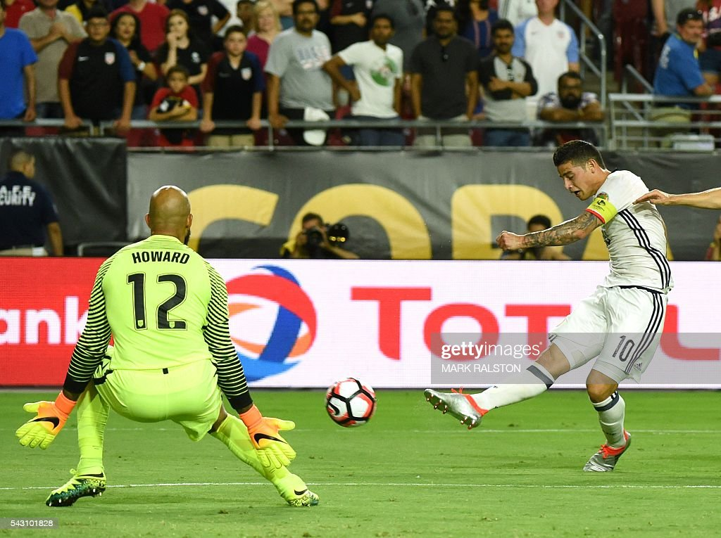 Colombia's James Rodriguez (R) kicks against USA's goalkeeper Tim Howard during the Copa America Centenario third place football match in Glendale, Arizona, United States, on June 25, 2016. / AFP / Mark RALSTON