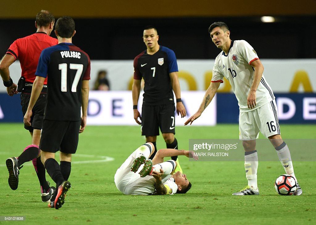 Colombia's James Rodriguez lies on the ground during the Copa America Centenario third place football match against the USA in Glendale, Arizona, United States, on June 25, 2016. / AFP / Mark RALSTON