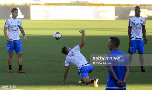 Colombia's James Rodriguez Radamel Falcao and Davinson Sanchez take part in a training session at the Metropolitano Stadium in Barranquilla on...