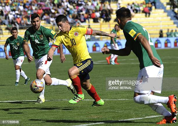 Colombia's James Rodriguez shoots to score against Bolivia during their Russia 2018 FIFA World Cup South American Qualifiers' football match in La...