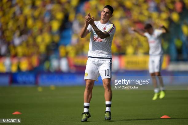 Colombia's James Rodriguez warms up before the start of the FIFA 2018 World Cup qualifier football match against Brazil in Barranquilla Colombia on...