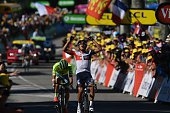 Colombia's Jarlinson Pantano celebrates as he crosses the finish line ahead of Poland's Rafal Majka at the end of the 160 km fifteenth stage of the...