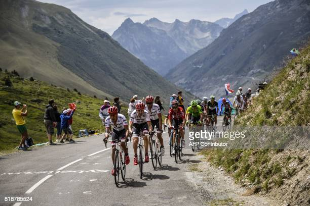 Colombia's Jarlinson Pantano Netherlands' Bauke Mollema Spain's Alberto Contador and France's Tony Gallopin ride in a breakaway past supporters...