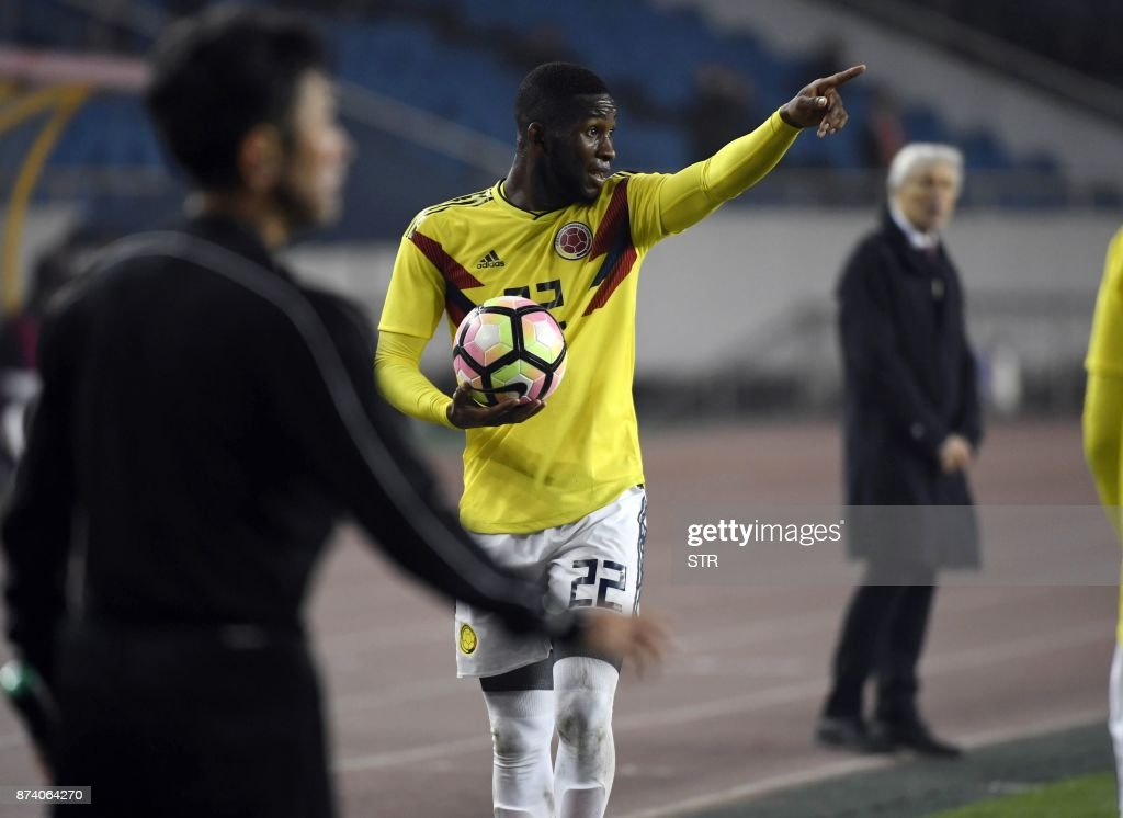 Colombia's Jefferson Lerma (C) gestures during their international friendly football match against China in Chongqing, southwest China on November 14, 2017. A Colombia side missing James Rodriguez punished China 4-0 away in a friendly on November 14 as coach Jose Pekerman made wholesale changes from the team defeated in acrimony in South Korea. / AFP PHOTO / STR / China OUT