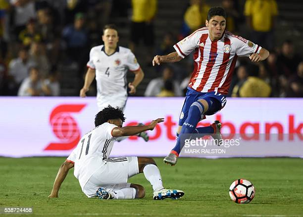 Colombia's Juan Cuadrado vies for the ball with Paraguay's Miguel Angel Almiron during a Copa America Centenario football match in Pasadena...