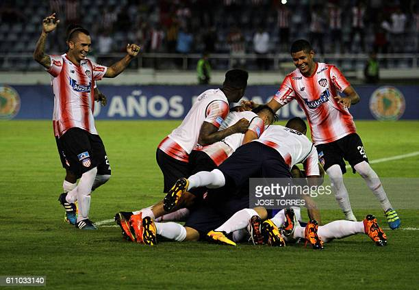 Colombia's Junior celebrate upon winning the match against Uruguay's Montevideo Wanderers for the Sudamericana Cup at the Metroplitano stadium in...