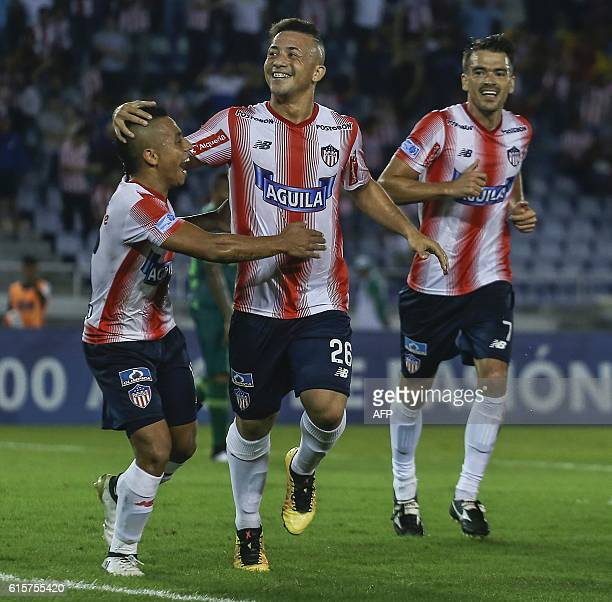 Colombia's Junior footballer Leiner Escalante celebrates with teammates after scoring against Brazil's Chapecoense during their Copa Sudamericana...