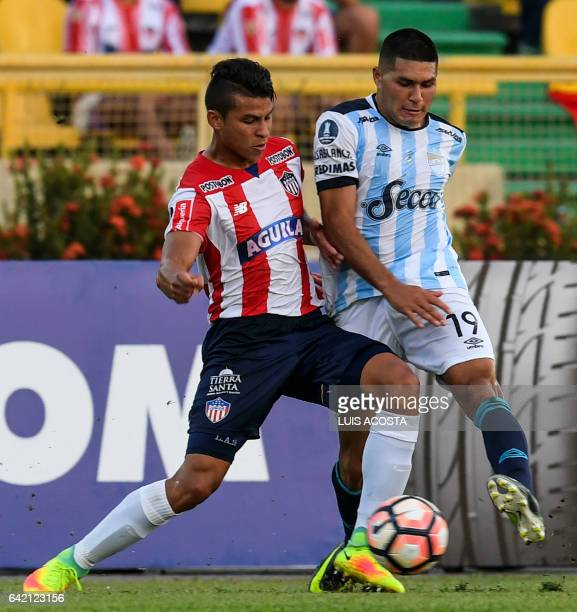 Colombia's Junior player Alexis Perez vies for the ball with Argentina's Atletico Tucuman player David Barbona during their Copa Libertadores 2017...