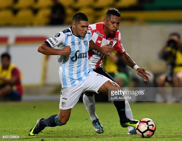 Colombia's Junior player James Sanchez vies for the ball with Argentina's Atletico Tucuman player David Barbona during their Copa Libertadores 2017...