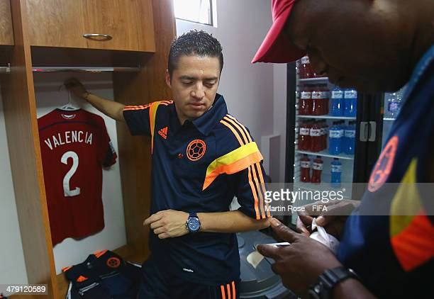 Colombia's kit manager David Hernadez prepars the jerseys prior to the FIFA U17 Women's World Cup 2014 group D match between Mexico and Colombia at...