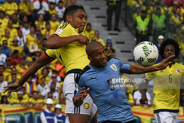 Colombia's Luis Fernando Muriel and Uruguay's Carlos Sanchez vie for the ball during their Russia 2018 FIFA World Cup qualifier football match in...