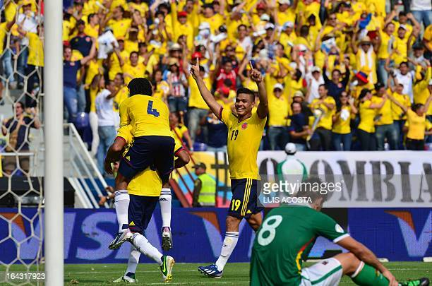 Colombia's Macnelly Torres celebrates with teammate Juan Cuadrado and Teofilo Gutierrez after scoring against Bolivia during their Brazil 2014 World...